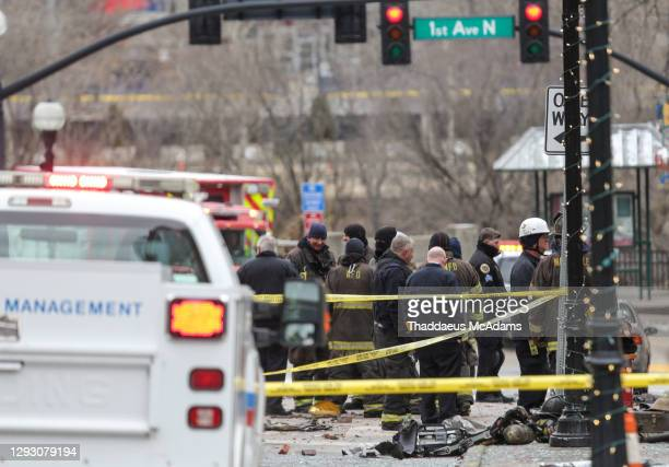 And first responders work the scene after an explosion on December 25, 2020 in Nashville, Tennessee. According to initial reports, a vehicle exploded...