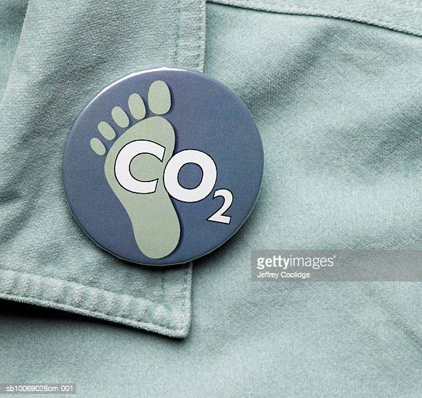 CO2 and footprint button on collar, close-up