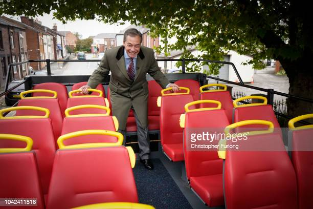 MEP and former leader of the UK Independence Party Nigel Farage duks to avoid low branches as hetravels on the proBrexit 'Leave Means Leave' battle...