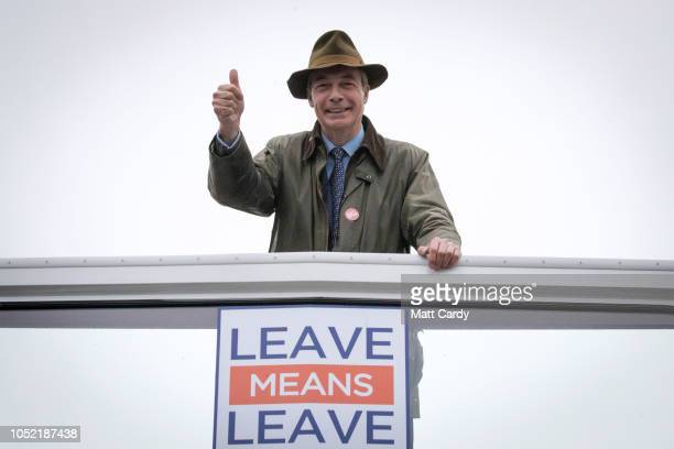 MEP and former leader of the UK Independence Party Nigel Farage leaves on the 'Leave Means Leave' bus following a walkabout at Christchurch street...
