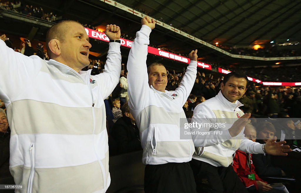 and Forwards coach Graham Rowntree, Head Coach Stuart Lancaster of England and backs coach Andy Farrell of England celebrate during the QBE International match between England and New Zealand at Twickenham Stadium on December 1, 2012 in London, England.