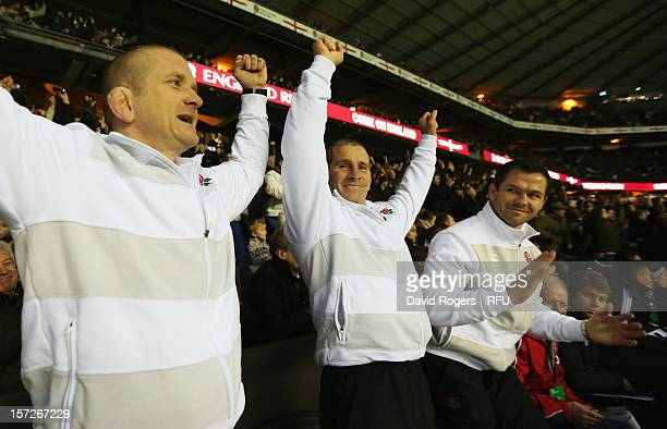 and Forwards coach Graham Rowntree Head Coach Stuart Lancaster of England and backs coach Andy Farrell of England celebrate during the QBE...