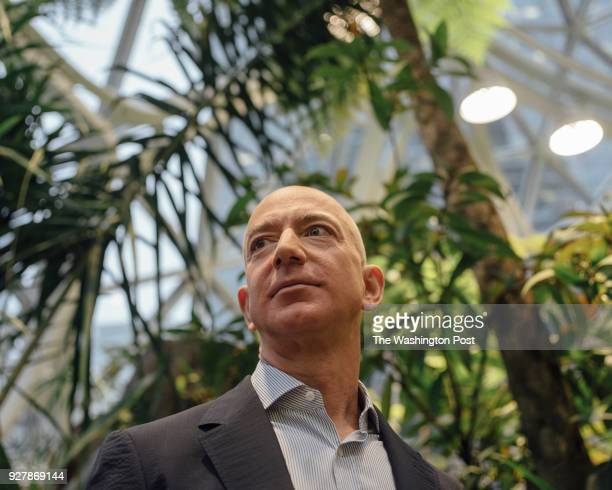 And Founder Jeff Bezos is taken on a tour of the plants around The Spheres during the grand opening at the Amazon Spheres in Seattle, Washington on...