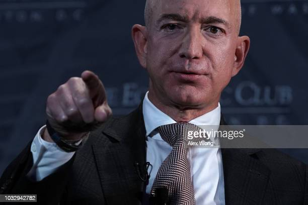 CEO and founder of Amazon Jeff Bezos participates in a discussion during a Milestone Celebration dinner September 13 2018 in Washington DC Economic...