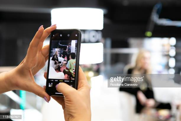 CEO and founder of Anastasia Beverly Hills Anastasia Soare is seen on the screen of a smart phone during an interview At Sephora Milano Duomo on...