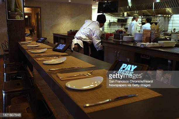 And founder Rajat Suri of E la Carte, a new tablet that restaurants can put at every table for do-it-yourself ordering and paying the bill at Calafia...
