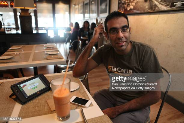 And founder Rajat Suri of E la Carte, a new tablet that restaurants can put at every table for do-it-yourself ordering and paying the bill, talking...