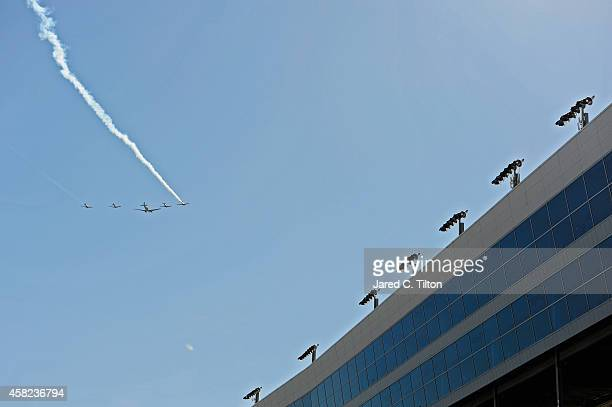 C47 and four T6's from Cavanaugh Flight Museum perform a flyover as part of prerace ceremonies for the NASCAR Nationwide Series O'Reilly Auto Parts...