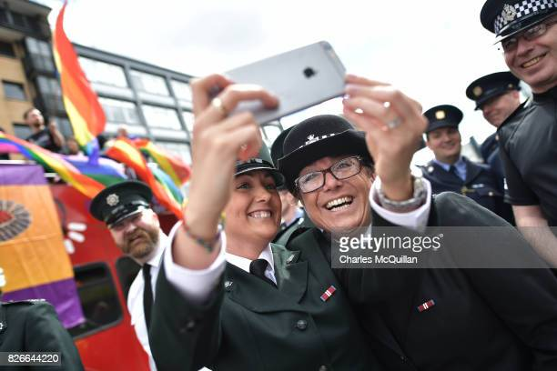 PSNI and Garda officers representative of the gay community take a selfie before taking part in the Belfast Gay Pride parade on August 5 2017 in...