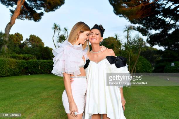 And Giovanna Battaglia and Bianca Brandolini attend the amfAR Cannes Gala 2019 at Hotel du Cap-Eden-Roc on May 23, 2019 in Cap d'Antibes, France.