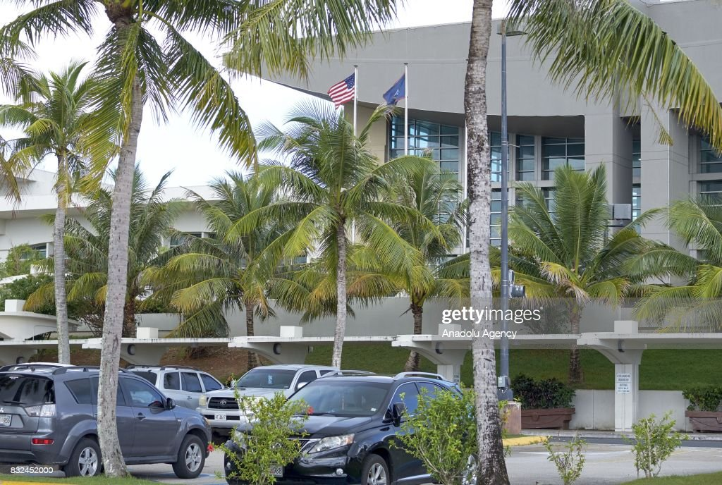 US and Guam national flags are seen in Tumon, Guam on August 16, 2017. With the threat of missiles from North Korea the number of tourists have dropped slightly, and while the rest of the world is uneasy, island residents continue on with their daily lives.
