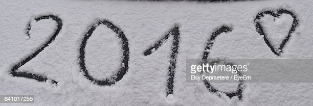 2016 and heart shape made in snowy field - 2016 stock pictures, royalty-free photos & images