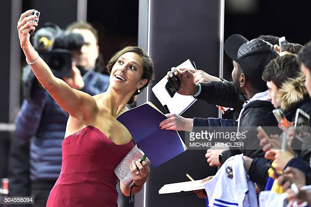 USA and Houston Dashs midfielder Carli Lloyd poses for a selfie with fans on the red carpet as she arrives for the 2015 FIFA Ballon d'Or award...