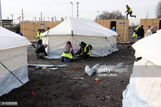 MSF and humanitarian associations volunteers build shelters for migrants and refugees who arrive in the first internationalstandard refugees camp...