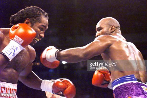 And IBF Heavyweight Champion Evander Holyfield and WBC Heavyweight Champion Lennox Lewis trade punches in the seventh round in Las Vegas, NV, 13...