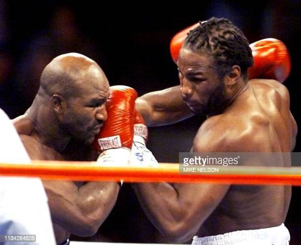 WBA and IBF Heavyweight Champion Evander Holyfield from the US and WBC heavyweight Champion Lennox Lewis from Great Britain exchange punches in the...