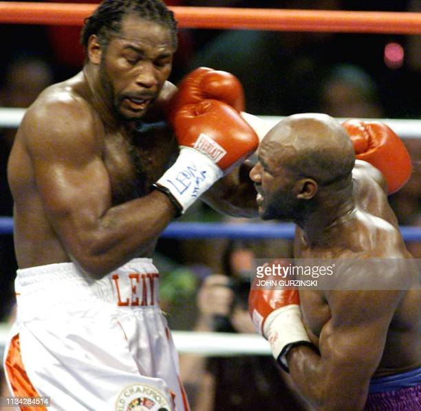 WBA and IBF Heavyweight Champion Evander Holyfield from the US lands a right against WBC heavyweight Champion Lennox Lewis from Great Britain in the...