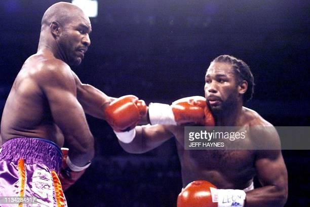 WBA and IBF Heavyweight Champion Evander Holyfield from the US lands a left to WBC Heavyweight Champion Lennox Lewis from Great Britain during 3rd...