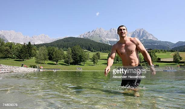 And IBO World Heavyweight Champion Wladimir Klitschko of Ukraine enjoys a morning swim at the Going Bergsee in front of the Tyrolian Mountains...