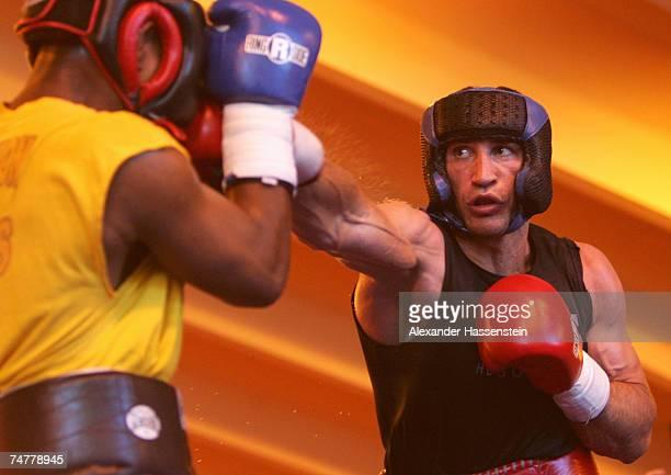 And IBO World Heavyweight Champion Wladimir Klitschko of Ukraine in action during a training session on June 19, 2007 in Going near Kitzbuhel,...