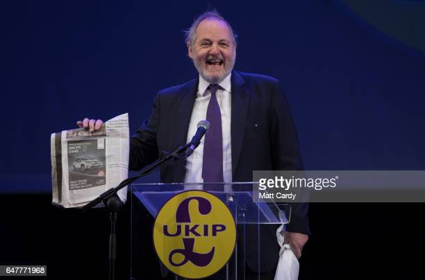 MEP and international trade spokesman William Dartmouth holds a copy of The Times newspaper as he speaks at the UKIP South West regional conference...