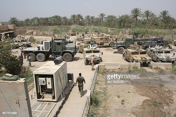 US and Iraqi forces armoured vehicles are parked at the camp Abara military base close to the northeastern restive town of Baquba on August 26 2008...