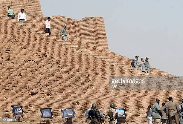 US and Iraqi soldiers are seen at ancient Ur during a handing over ceremony between the US military and Iraqi offcials in southern central Iraq on...