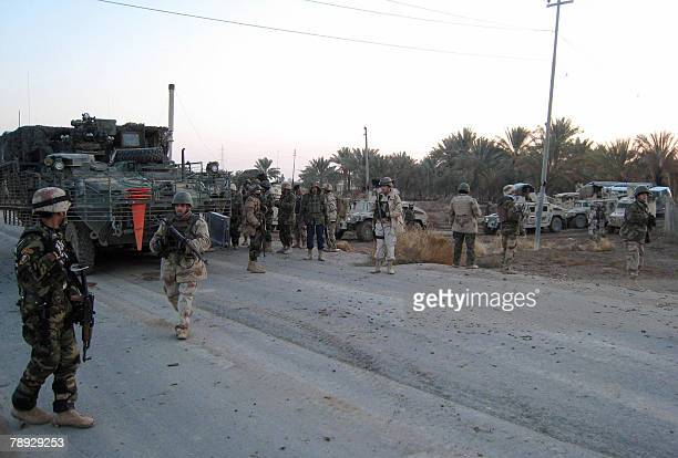 US and Iraqi soldiers deploy in an area on the outskirts of the restive city of Baquba northeast of Baghdad 14 January 2008 Six people were killed...