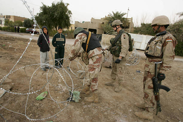 US and Iraqi soldiers place razor wire a Pictures   Getty Images