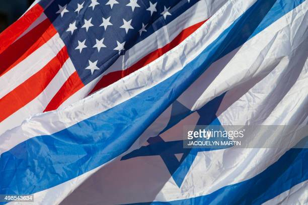 US and Israeli flags are seen as US Secretary of State John Kerry arrives in the Israeli coastal city of Tel Aviv on November 24 2015 Kerry arrived...