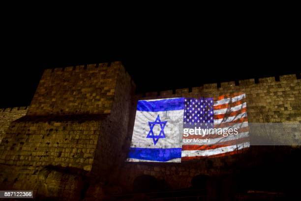 US and Israeli national flags projected on the wall of Jerusalem's Old City on December 6 2017 in Jerusalem Israel US President Donald Trump...