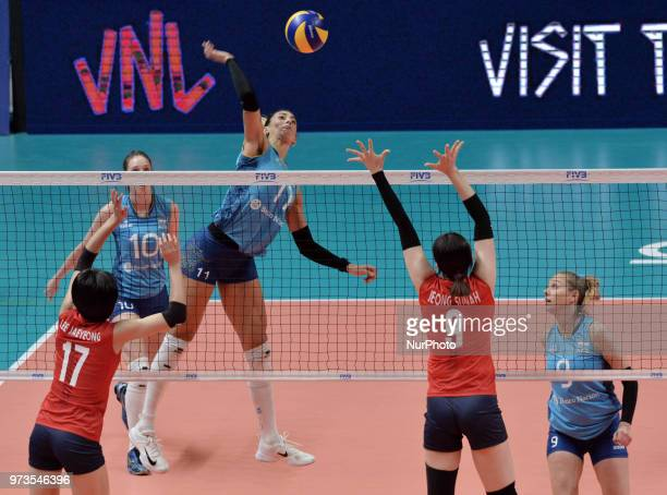 and JAEYEONG LEE of Korea against HELENA VIDAL of Argentina during FIVB Volleyball Nations League match between Argentina and South Korea at the...