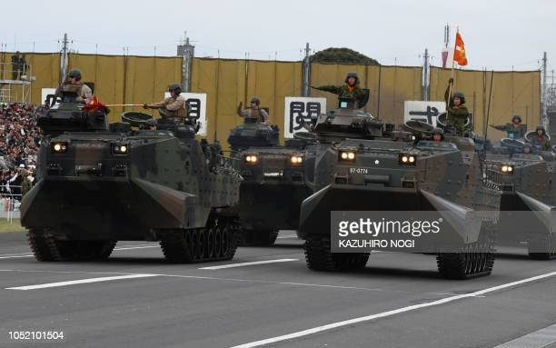 US and Japan amphibious unit vehicles take part in the military review at the Ground SelfDefence Force Asaka training ground in Asaka Saitama...