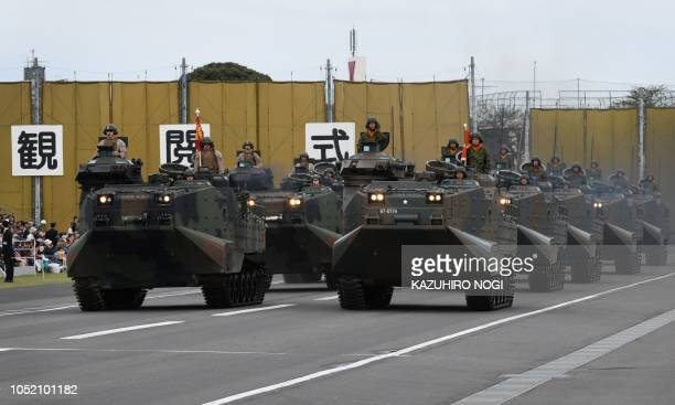 US and Japan amphibious unit vehicles takes part in the military review at the Ground SelfDefence Force Asaka training ground in Asaka Saitama...