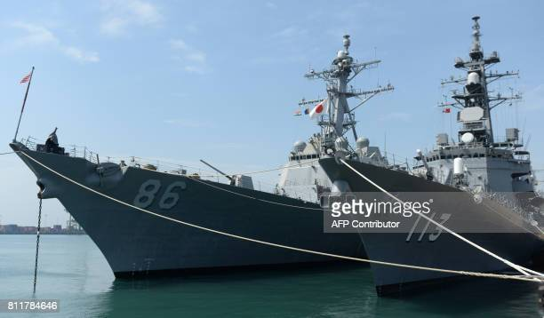 US and Japanese Navy ships are pictured docked at a harbour during the inauguration of joint naval exercises with India in Chennai on July 10 2017...