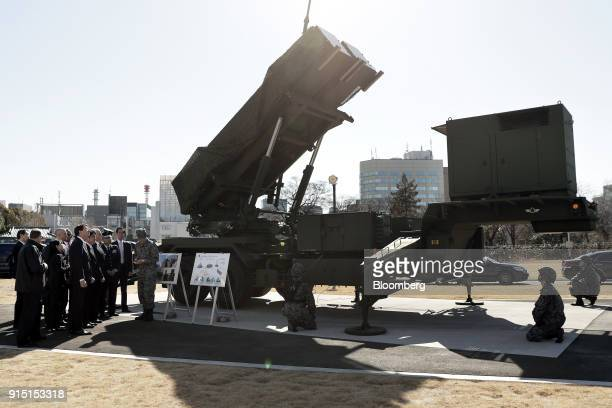 US and Japanese officials including US Vice President Mike Pence and Japan's defense minister Itsunori Onodera inspect a Japan selfdefense force...
