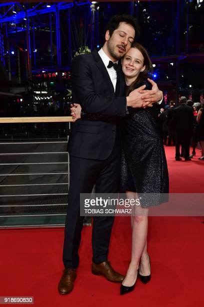 and Jasna Fritz Bauer and German actor of Turkish origin Fahri Yardim pose on the red carpet upon their arrival at the Berlinale Palace for the...