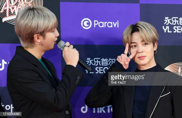 RM and Jimin of BTS arrive at the photo call for the 34th Golden Disc Awards on January 05 2020 in Seoul South Korea