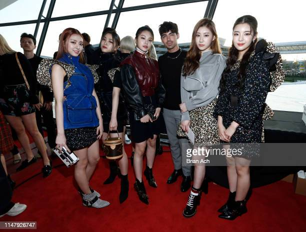 ITZY and Joe Jones attend the Louis Vuitton Cruise 2020 Fashion Show at JFK Airport on May 08 2019 in New York City