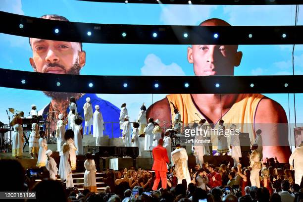 YG and John Legend perform in tribute to the late Nipsey Hussle and Kobe Bryant onstage during the 62nd Annual GRAMMY Awards at Staples Center on...