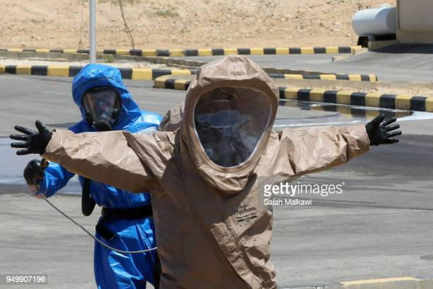 US and Jordanian soldiers participate in a chemical attack simulation to deal with any possible attack during Eager Lion exercise at the Chemical...