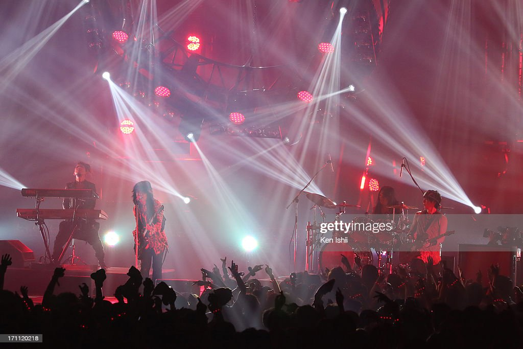 and K.A.Z (R) of VAMPS perom onstage during the MTV VMAJ 2013 at Makuhari Messe on June 22, 2013 in Chiba, Japan.