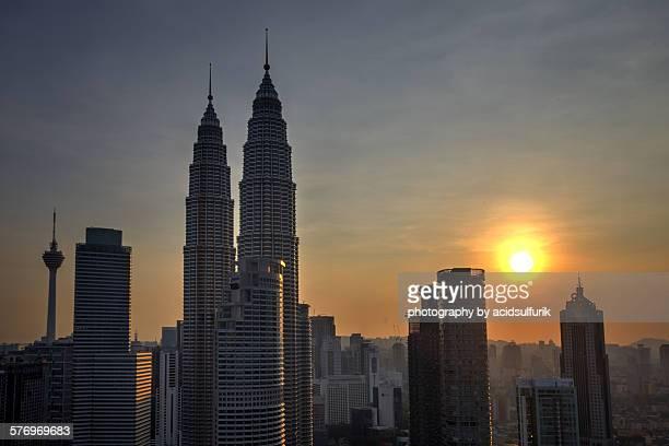 klcc and kl tower during hazy sunset - menara kuala lumpur tower stock photos and pictures