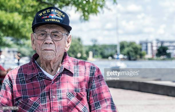 wwii and korean war military veteran at canandaigua lake - veterans stock photos and pictures