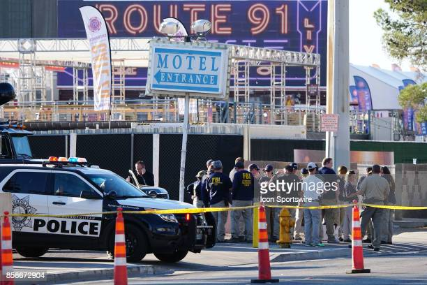 FBI and Las Vegas Metropolitan Police Department gather at one of the gates into the Route 91 Harvest Festival on October 6 after a mass shooting...
