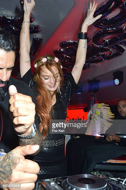 And Lindsay Lohan performs during the VIP Room JW Marriot : Day 8 - The 67th Annual Cannes Film Festival on May 21, 2014 in Cannes, France.