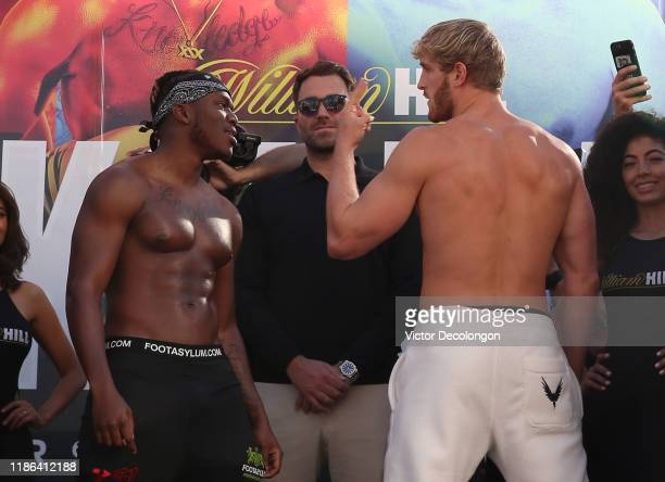 and Logan Paul face off as promoter Eddie Hearn looks on after the official weighin at LA Live Xbox Plaza on November 08 2019 in Los Angeles...