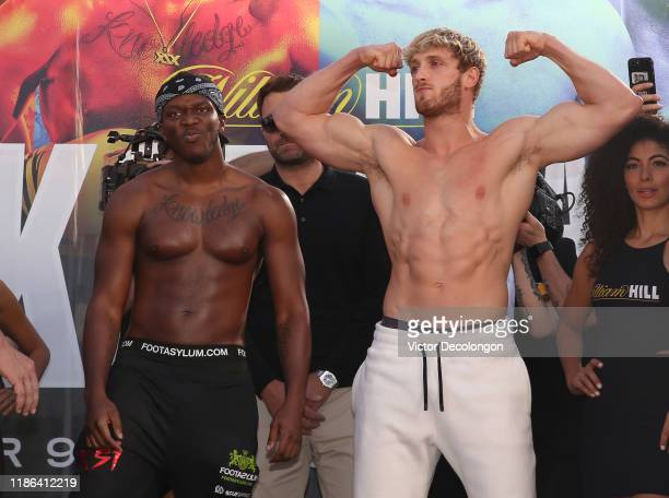 and Logan Paul face the audience after the official weighin at LA Live Xbox Plaza on November 08 2019 in Los Angeles California