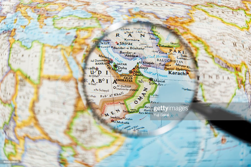 OMAN ,  UNITED ARAB EMIRATES  and Magnifying glass : Foto stock
