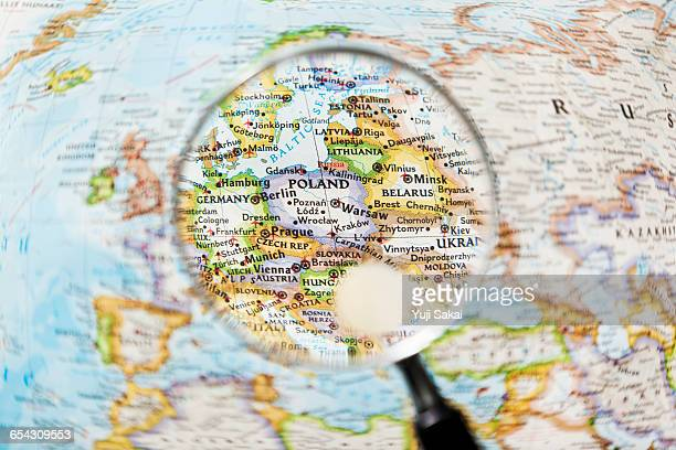POLAND and Magnifying glass